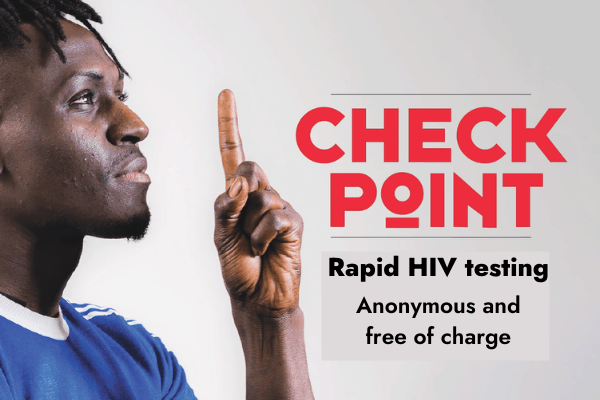 A man pointing a finger and advertising checkpoint rapid HIV testing service